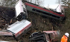 A rail worker stands at the scene of the Virgin train crash at Grayrigg in Cumbria Northern England
