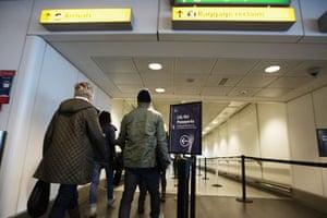 public sector strikes: Passengers walk through Terminal 3 at Heathrow Airport