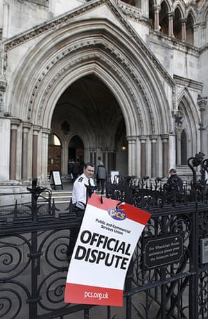public sector strikes: A placard is seen outside the High Court in central London