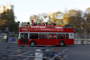Strike day: A bus carrying union members drives through Parliament Square in London