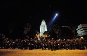 Occupy LA evictions: Los Angeles Police Department officers wait to walk into the Occupy camp