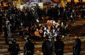 Occupy LA evictions: Protesters seated in circle in the middle of their encampment are arrested
