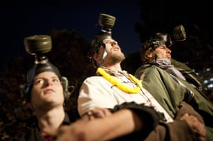 Occupy LA evictions: Occupy LA member wear gas masks as they protest outside City Hall