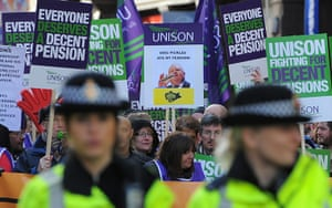 Strikers march: Demonstrators march with trade union placards in Manchester