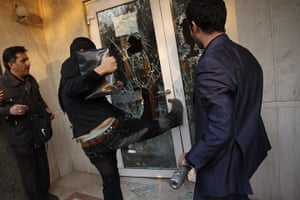 British Embassy, Iran: An Iranian protester kicks to break a door at the British embassy compound