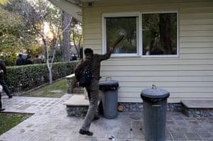 British Embassy, Iran: An Iranian man breaking a window inside the grounds of the British embassy