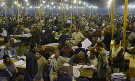 Election workers count ballots for Egypt's parliamentary elections in Luxor, Egypt