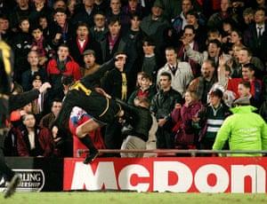 Fergie's 25 years: Manchester's Eric Cantona Kung Fu flying kicks Palace fan Matthew Simmons