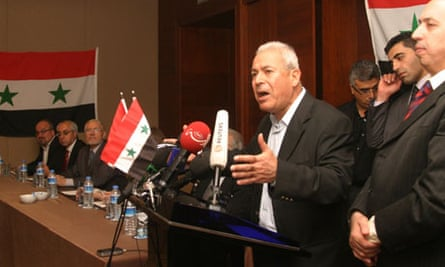 Syrian academic Burhan Ghalioun gives his address during a meeting in Istanbul