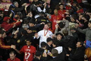 Fergie's 25 years: Alex Ferguson and the team descend the stairs after lifting the trophy