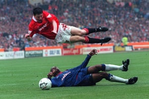 Fergie's 25 years: Manchester United's Denis Irwin is up-ended by Chelsea's Eddie Newton