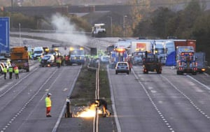 M5 crash day 2: A welder works on a central barrier on the M5 near the crash