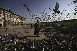 24 hours in pictures: A man feeds pigeons outside Shah-e-Dushamshera mosque in Kabul