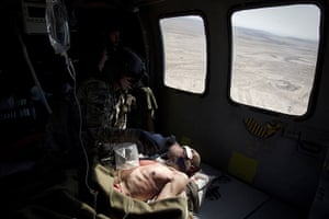 24 hours in pictures: US Flight Medic helps a severely wounded Afghan elder