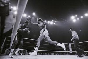 Joe Frazier: Muhammad Ali lunges at Joe Frazier - Thrilla in Manila 1975
