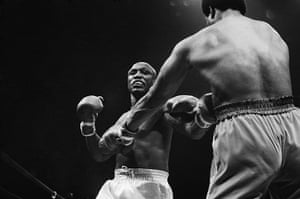 Joe Frazier: boxers joe frazier and george foreman fighting in 1976