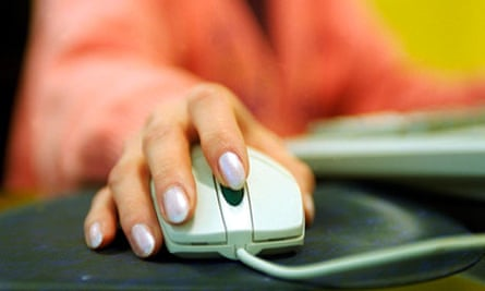 A woman using a PC computer mouse