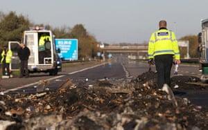 M5 accident: A police collision investigator officer walks through debris