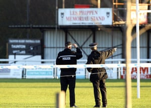M5 accident: Police officers walk on the pitch at Taunton Rugby Club's ground