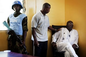 Liberia violence: Opposition leader Winston Tubman is comforted after an attack on his HQ