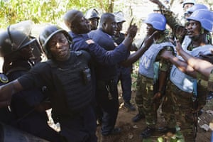 Liberia violence: Nigerian United Nations peacekeepers, right,  confront Liberian riot police