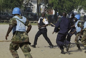 Liberia violence: UN soldiers and Liberian police chase down a Liberian police commander
