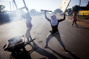 Liberia violence: Opposition supporters set up a burning barricade in the capital Monrovia