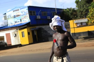 Liberia violence: An opposition supporter carries a spent tear gas canister
