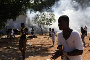 Liberia violence: Opposition party supporters flee their party's headquarters