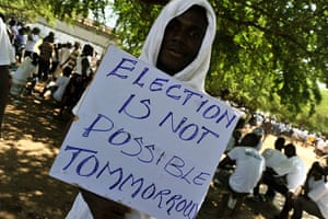 Liberia violence: A supporter of the opposition CDC party holds a placard at a rally