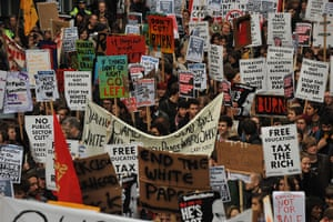 Student protests: Student demonstrators carry banners as they march against cuts in London