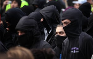 Student protests: Hooded protestors march as students take part in a demonstration