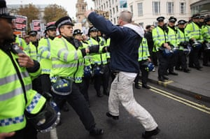 Student protests: A man tussles with police as students take part in a demonstration