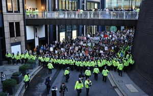 Student protests update: Demonstrators walk past the Museum of London