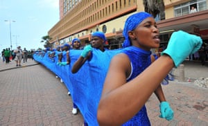 COP17 in Durban:  South African dancers making a blue line lead a 3kms Walk for the Future