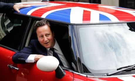 David Cameron in a Mini Cooper decorated with the union flag