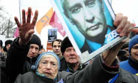 A Russian woman holds an anti-Putin placard in Bolotnaya square