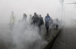 Moscow protests: People make their way to the demonstration through smoke from a flare