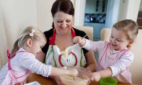 Emma Trappett, with three year-old twins Sienna, left, and Jessica.