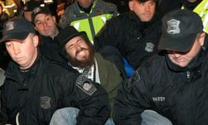 Police remove an Occupy Boston protester from Dewey Square