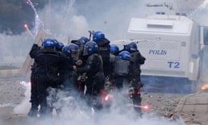 Riot police and Kurdish demonstrators.