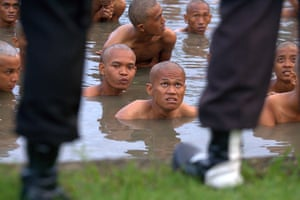 Indonesia punks: Arrested punks take a bath before moral education at a police school