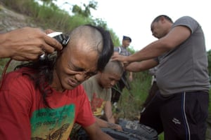 Indonesia punks: Police officers shave the heads of punks after they were arrested