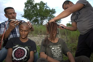 Indonesia punks: Police officers shave the heads of punks