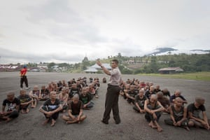 Indonesia punks: A police officer lectures a group of detained punks at a police school