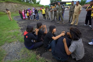 Indonesia punks: Female punks wait for their hair to be cut by the police