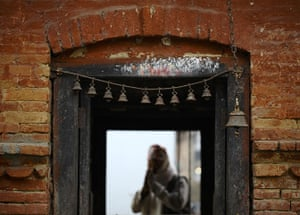 24 hours in pictures: A man offering morning prayers in Lalitpur, NEpal