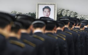 24 hours in pictures: coast guard officer mourned in Korea
