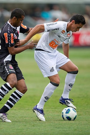 Man Utd targets: Santos' Paulo Henrique Ganso shields the ball from Vasco's Renato Silva