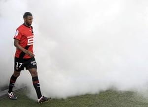 Man Utd targets: Rennes' midfielder Yann M'Vila arrives through smoke on the pitch